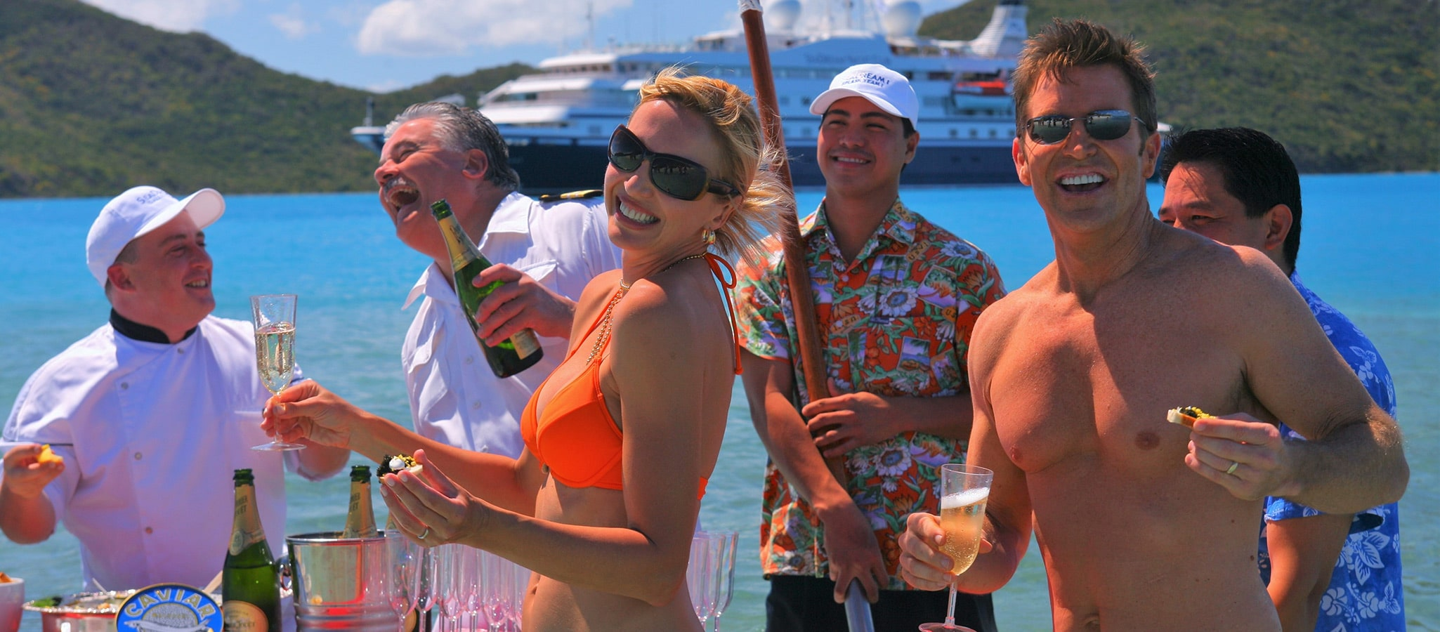 An extraordinary event: champagne & caviar splash on a Caribbean beach.